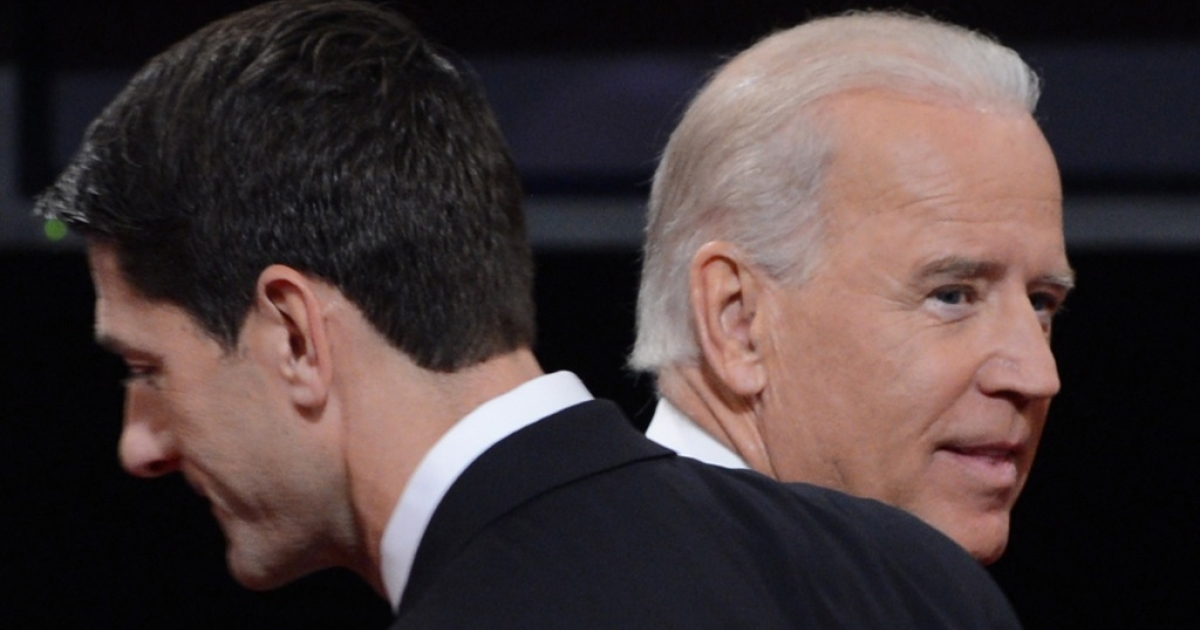 US Vice President Joe Biden (R) and Republican vice presidential candidate Paul Ryan (L) depart the stage following their debate at the Norton Center at Centre College in Danville, Kentucky, October 10, 2012, moderated by Martha Raddatz of ABC News.</p>