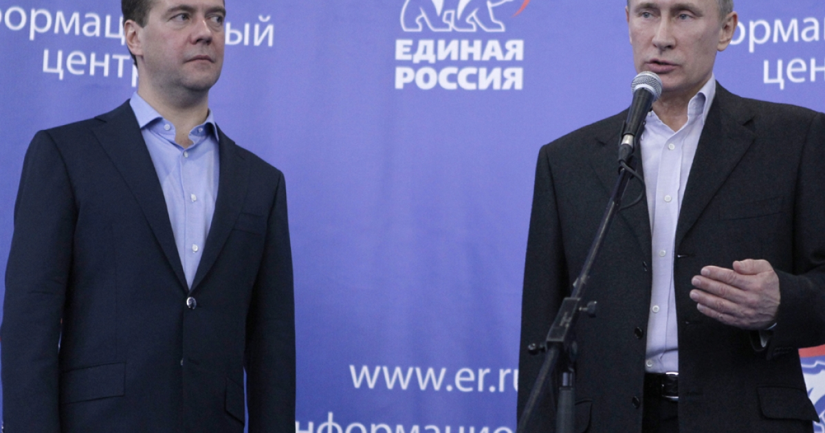 Russia's President Dmitry Medvedev (L) and Prime Minister Vladimir Putin (R) speak to supporters in the United Russia ruling party's campaign staff in Moscow, on December 4, 2011.</p>