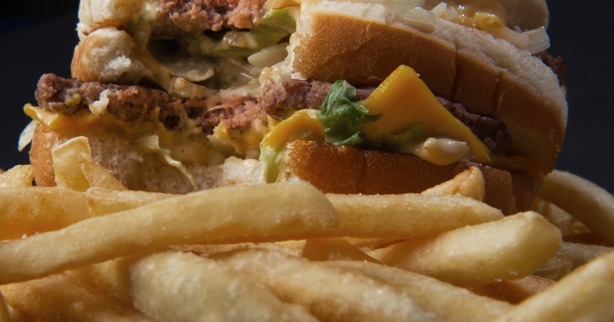 A partially eaten McDonald's Big Mac and fries.</p>