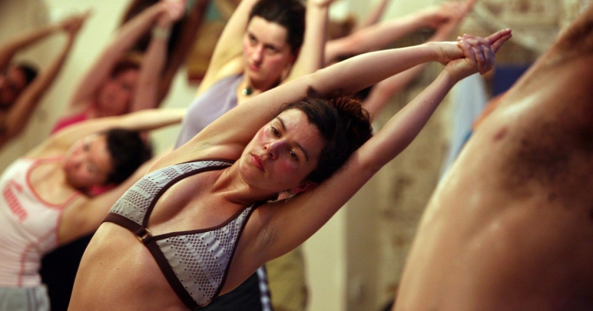 Yes, it hurts. In a good way. Students practice the unique Bikram Yoga on March 13 2007 in London, England.</p>