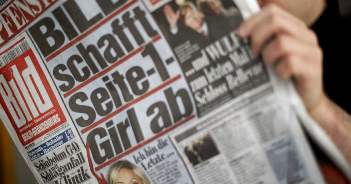 Man reads Bild, Germany's popular tabloid.</p>