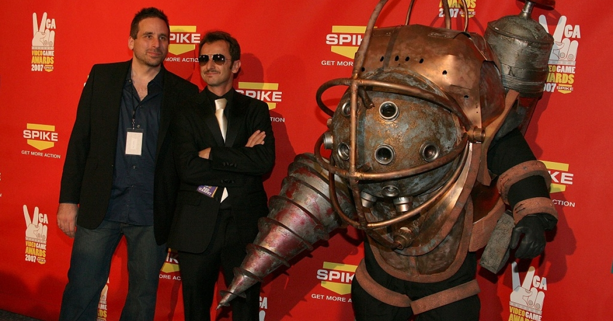 Bioshock Creative Directors Ken Levine (L) and Greg Gobbi (C) pose with the 'Bioshock' character at Spike TV's 2007 'Video Game Awards' at the Mandalay Bay Events Center on December 7, 2007 in Las Vegas, Nevada.</p>