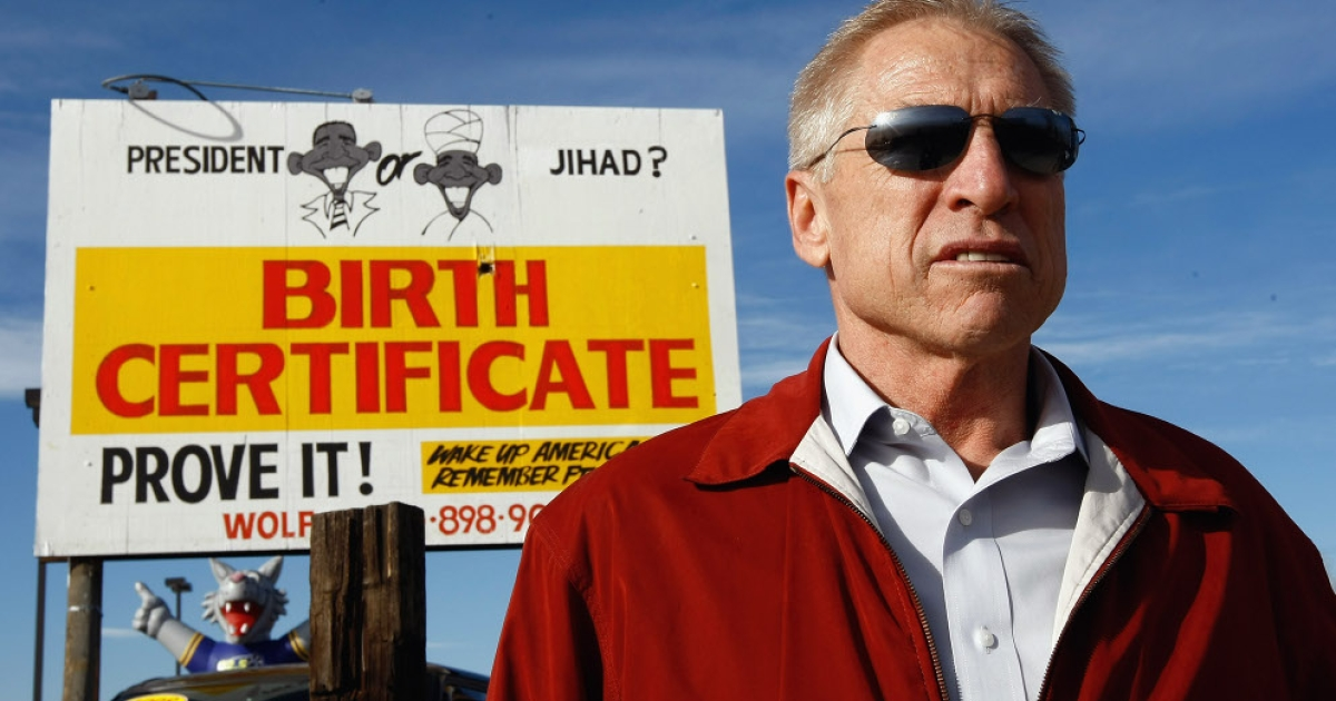 Phil Wolf, owner of Wolf Automotive, stands in front of a billboard on his auto lot on November 21, 2009 in Wheat Ridge, Colorado. Wolf, a birther said he received death threats after posting the billboard.</p>