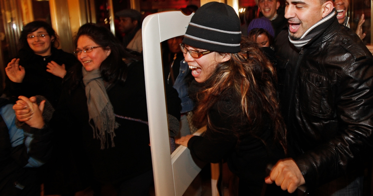 Shoppers rush through the doors of Macy's at 5a.m. ET in search of Black Friday bargains in New York, November 27, 2009.</p>