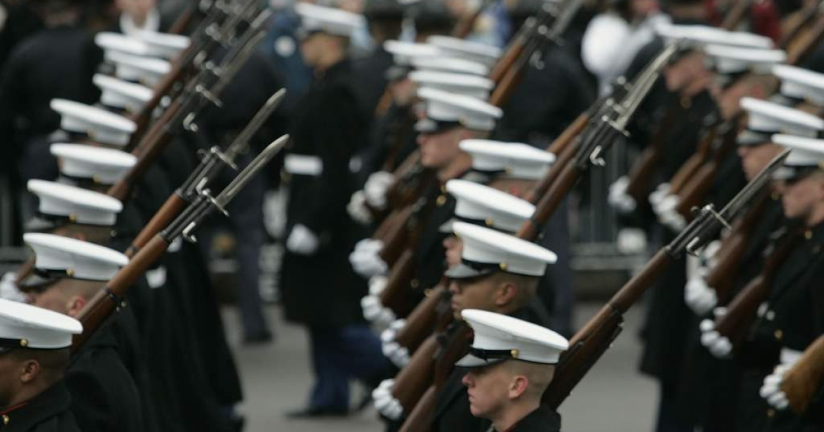 U.S. Marines march during U.S. President George W. Bush's inaugural parade January 20, 2005 in Washington, D.C.</p>