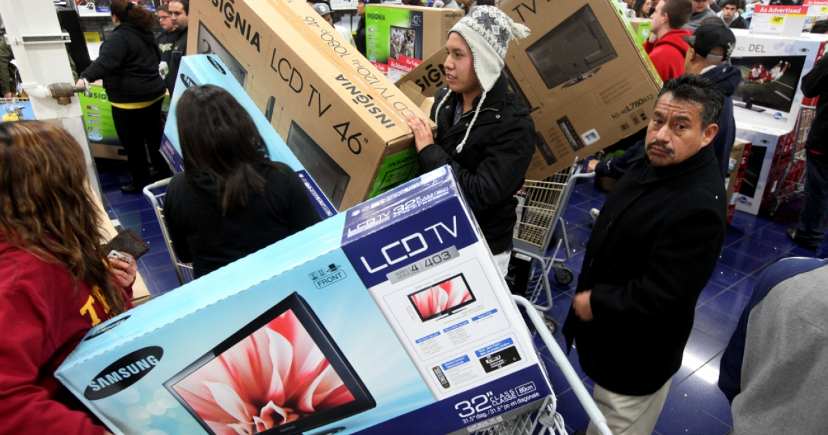 SAN DIEGO, CA - NOVEMBER 25: Customers shop for electronics items during 'Black Friday' at a Best Buy store on November 25, 2011 San Diego, California.</p>
