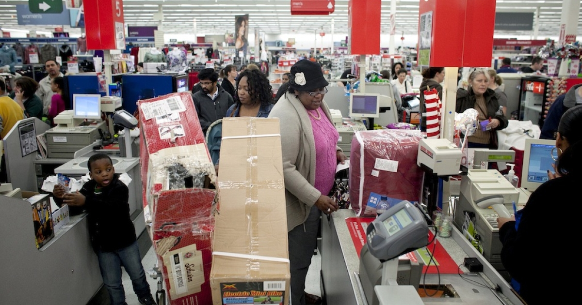 BRAINTREE, MA - NOVEMBER 23:  Shoppers wait in a check out line at Kmart during the Black Friday sales on November 23, 2012 in Braintree, Massachusetts. Black Friday, the official start of the holiday shopping season, has traditionally been the busiest shopping day in the United States. (Photo by Allison Joyce/Getty Images)</p>