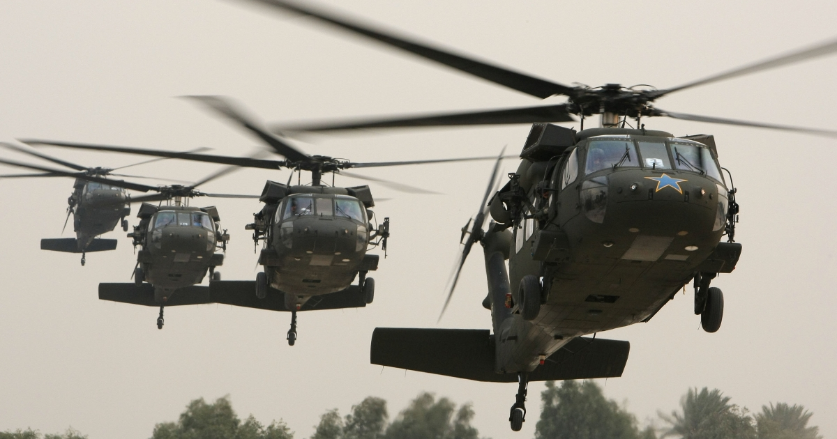 A Black Hawk helicopter, right, carrying Robert Gates, then the US Secretary of Defense, arrives in Baghdad's so-called Green Zone in December, 2009.</p>