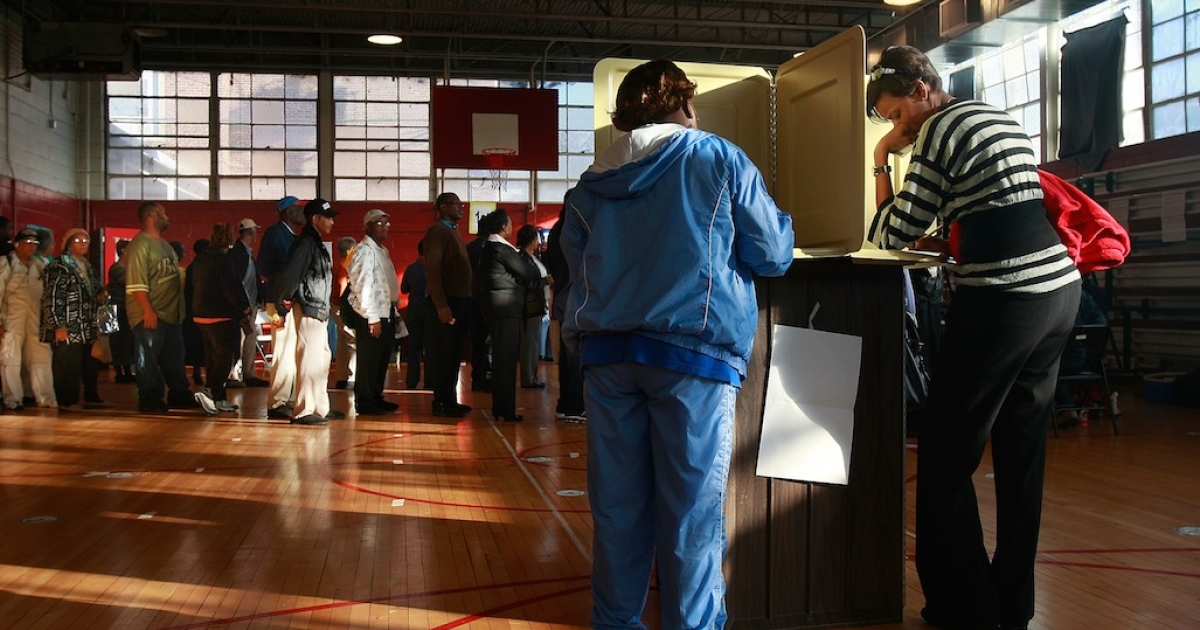 African-Americans line up to vote in a school gymnasium in the presidential election November 4, 2008 in Birmingham, Alabama.</p>