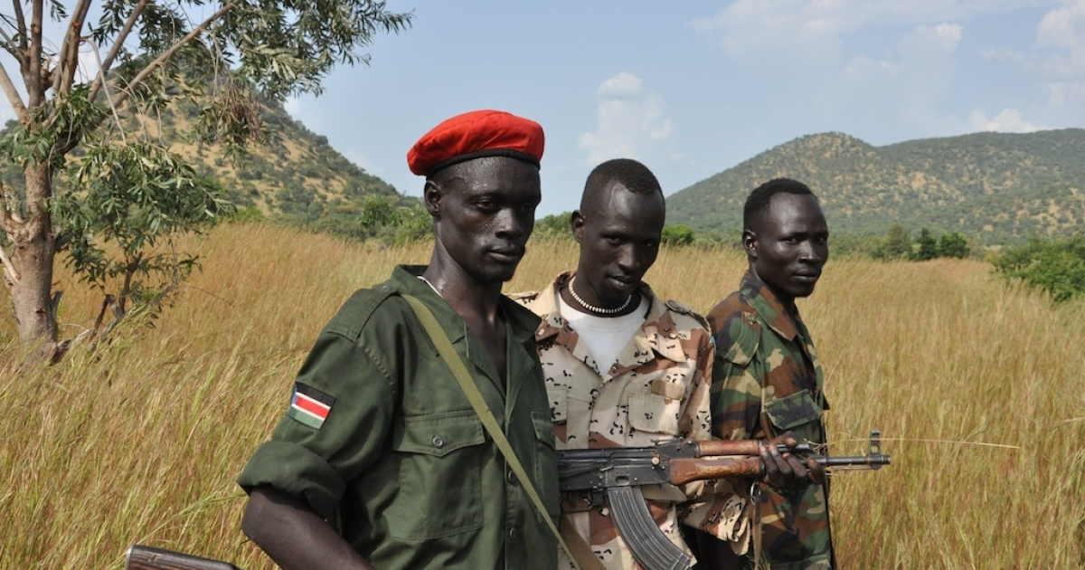 SPLM-N fighters stand outside the village of Maiyas.  An Antonov bomb recently struck the village the soldiers were guarding and killed six people.</p>
