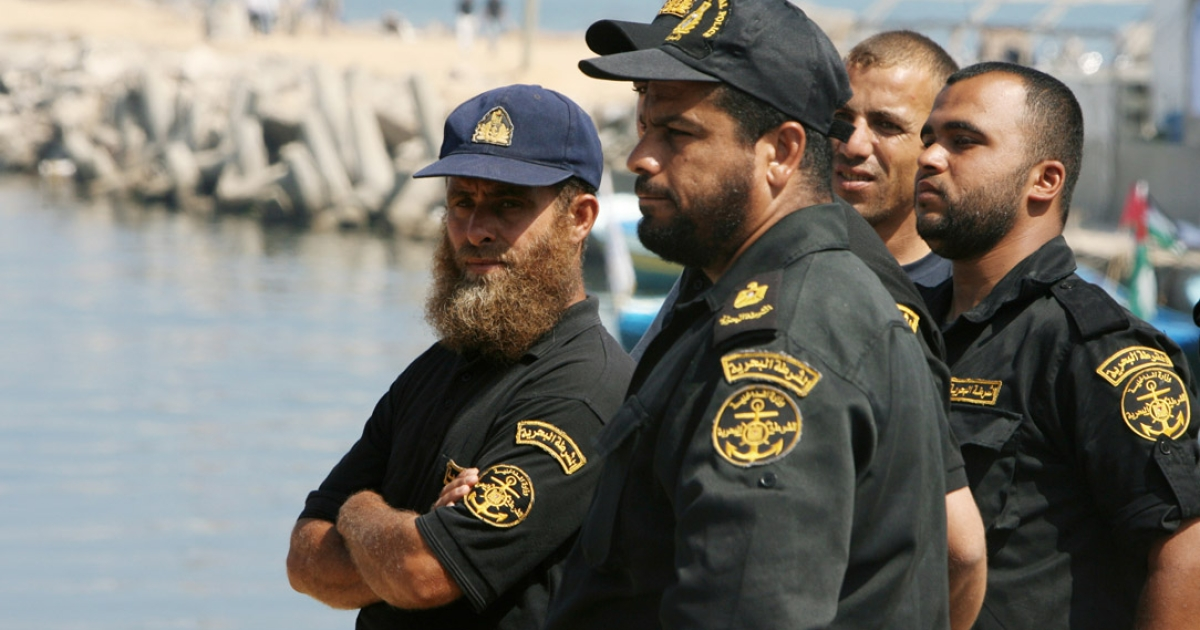 Palestinian Hamas naval policemen gather at the port of Gaza City on May 31, 2010, following a deadly Israel military raid on a Gaza-bound flotilla of aid ships in which several passengers were killed, sparking fury from Turkey and calls for an