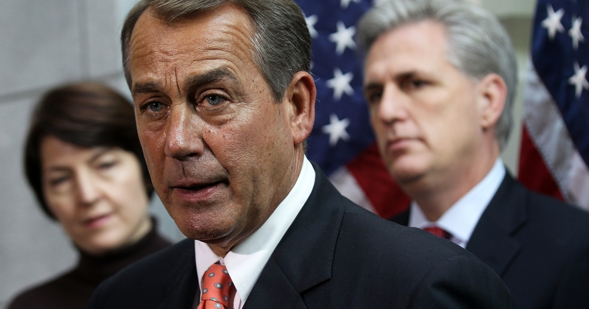 US Speaker of the House Rep. John Boehner (R-Ohio) (C) speaks as Rep. Cathy McMorris Rodgers (R-Wash.) (L) and House Majority Whip Rep. Kevin McCarthy (R-Calif.) listen following a Republican Conference meeting on Capitol Hill on Dec. 16, 2011.</p>