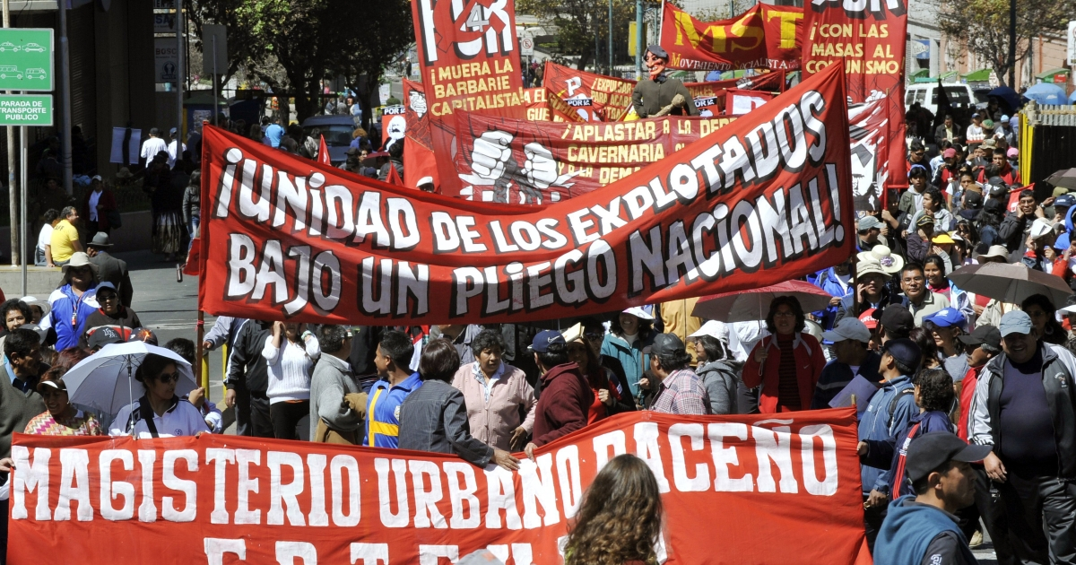 Labor unions march in La Paz, Bolivia on May 1, Labor Day, ahead of President Evo Morales' announcement that Bolivia is taking control of the Spanish-run electrical grid.</p>