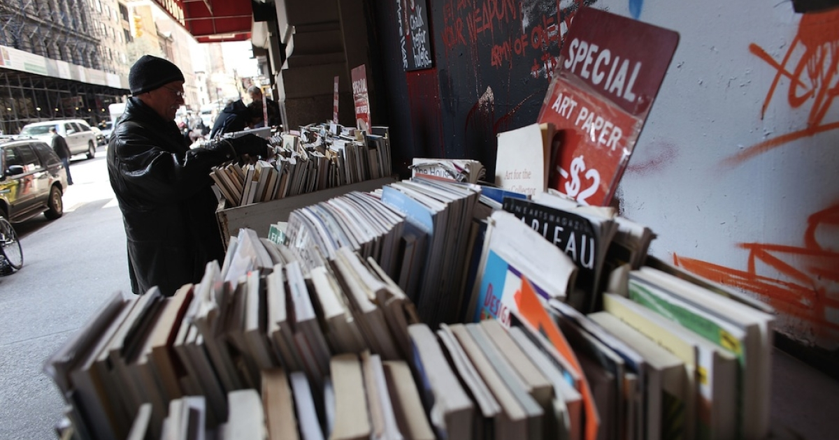 A man looks at books on April 2, 2012 in New York City.</p>