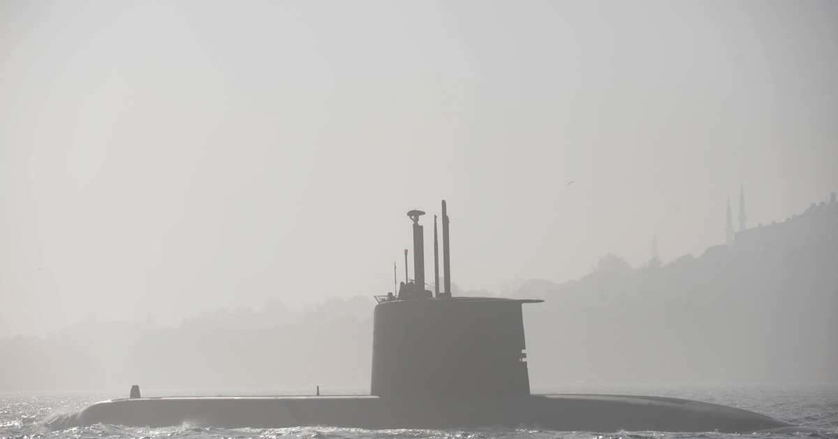 A submarine sails through the Bosphorus strait in Istanbul during a heavy fogy day on Nov. 6 2010.</p>