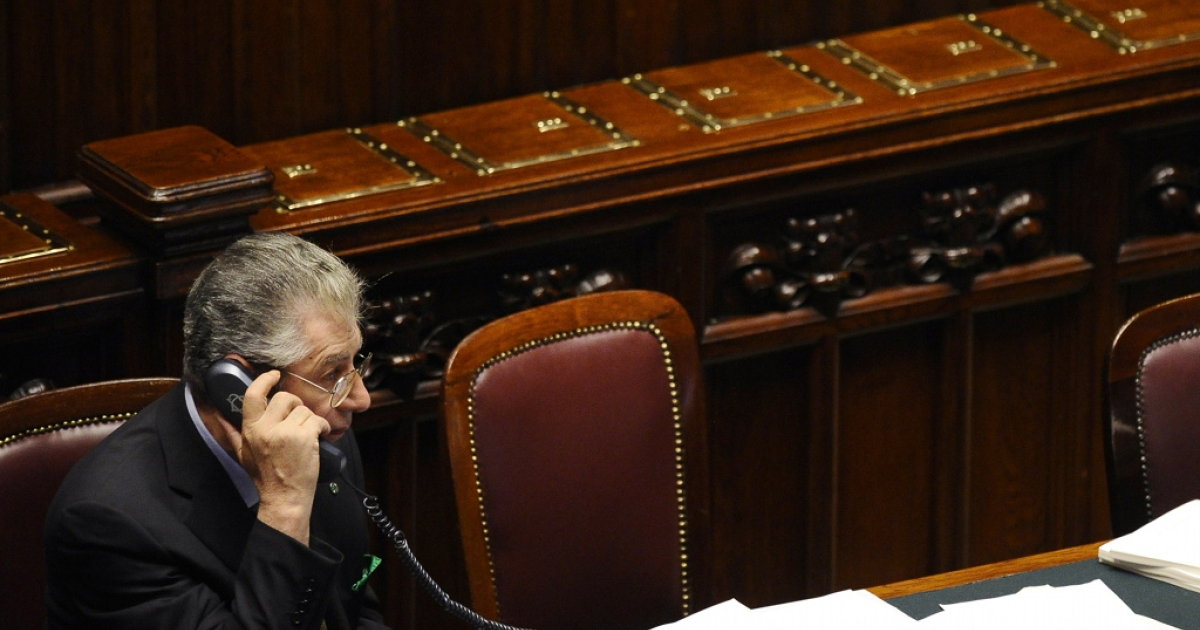 Italian politician Umberto Bossi (pictured last week in the Italian parliament) has a bunt message to new Prime Minister Mario Monti is, Call me if you want to talk ... but I make no promises.</p>