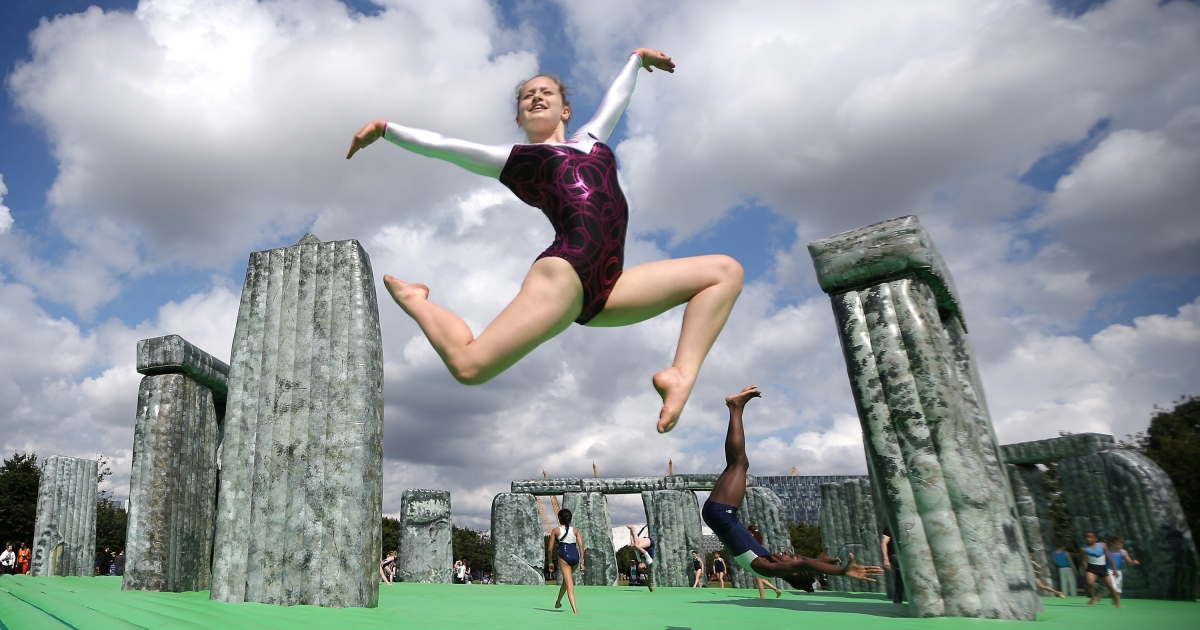 Gymnasts bounce on an inflatable version of Stonehenge designed by artist Jeremy Deller at the Greenwich Peninsula on July 21, 2012, in London, England.</p>