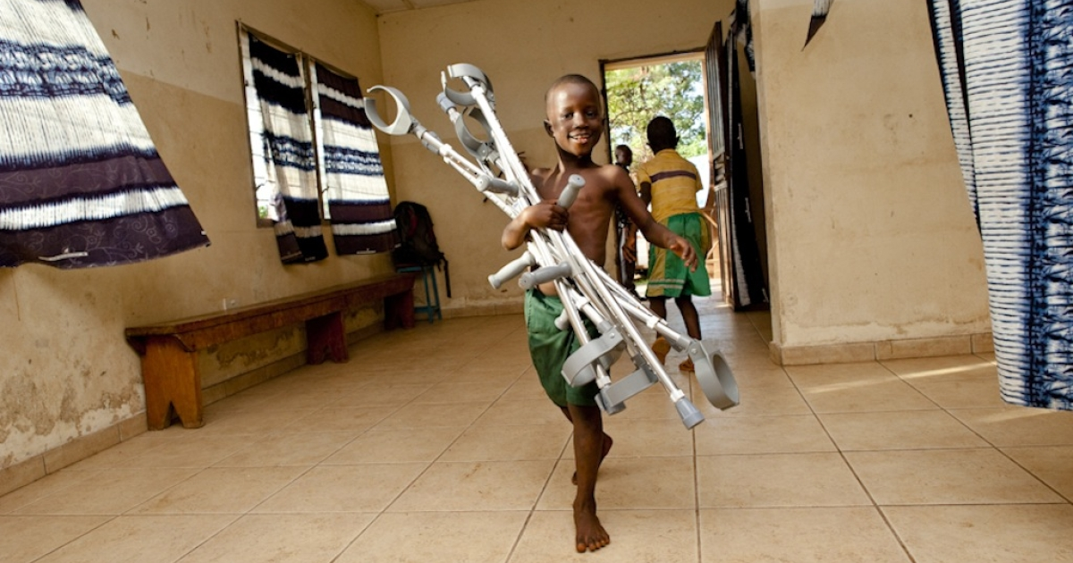 Operation Rise, run by an American organization called The Peace Project, handed out crutches on Sept. 21, 2011, to landmine victims, polio sufferers and amputees from the brutal decade-long civil war in Sierra Leone.  A boy carries some new crutches at one of the Operation Rise distribution centers in Aberdeen, Freetown.</p>