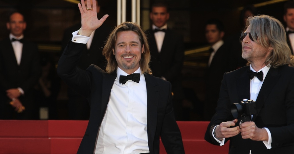 New Zealand's director Andrew Dominik and US actor Brad Pitt (L) arrive for the screening of 'Killing them Softly' presented in competition at the 65th Cannes film festival on May 22, 2012 in Cannes.</p>