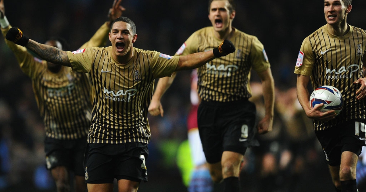 Nathan Doyle and his Bradford City teammates celebrate reaching the Capital One Cup final after beating Aston Villa on January 22, 2013 in Birmingham, England.</p>