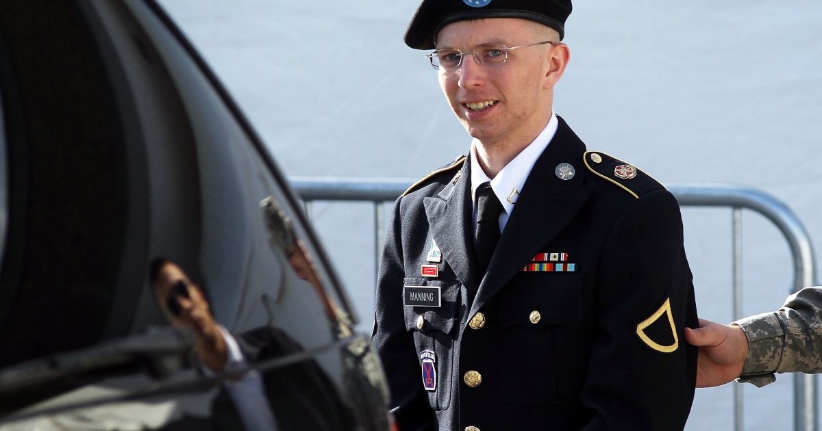 US Army Private Bradley Manning is escorted as he leaves a military court at the end of the first of a three-day motion hearing June 6, 2012, in Fort Meade, Md.</p>