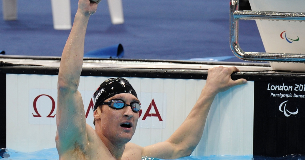 Bradley Snyder of the United States celebrates after winning gold in the Men's 400m Freestyle - S11 final on day 9 of the London 2012 Paralympic Games at Aquatics Centre on September 7, 2012 in London, England.</p>