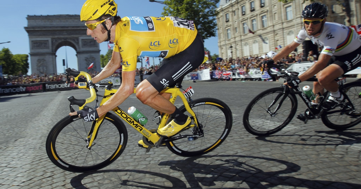 Bradley Wiggins of Team Sky leads teammate Mark Cavendish around the Arc de Triomphe during the final stage of the 2012 Tour de France on July 22, 2012, in Paris.</p>
