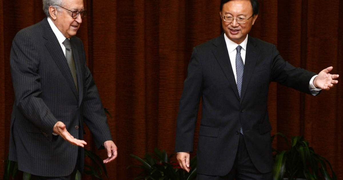 UN-Arab League peace envoy for Syria Lakhdar Brahimi greets Chinese Foreign Minister Yang Jiechi prior to their meeting at the Ministry of Foreign Affairs on October 31, 2012 in Beijing, China. Brahimi is on a two-day visit to China.</p>