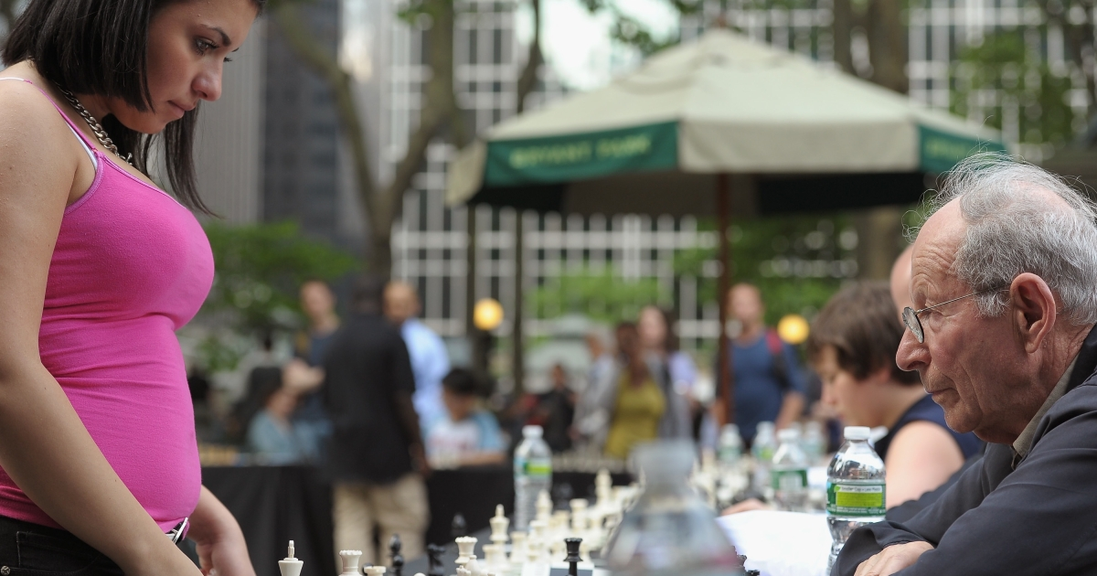 Alena Kats and Emanuel Grunfeld face off in the HBO Bryant Park Chess Challenge in New York City's Bryant Park on May 24, 2011.</p>