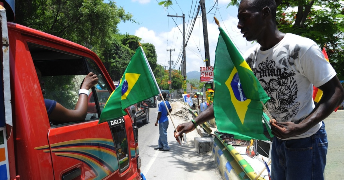 A Haitian man sells flags of Brazil, one of the countries taking part in the World Cup soccer in South Africa on June 10, 2010 in the streets of Petion-ville, Haiti.</p>