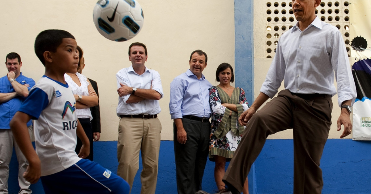 U.S. President Barack Obama plays soccer with some children while visiting Ciudad de Dues Favela in Rio de Janiero, Brazil, March 20, 2011.</p>