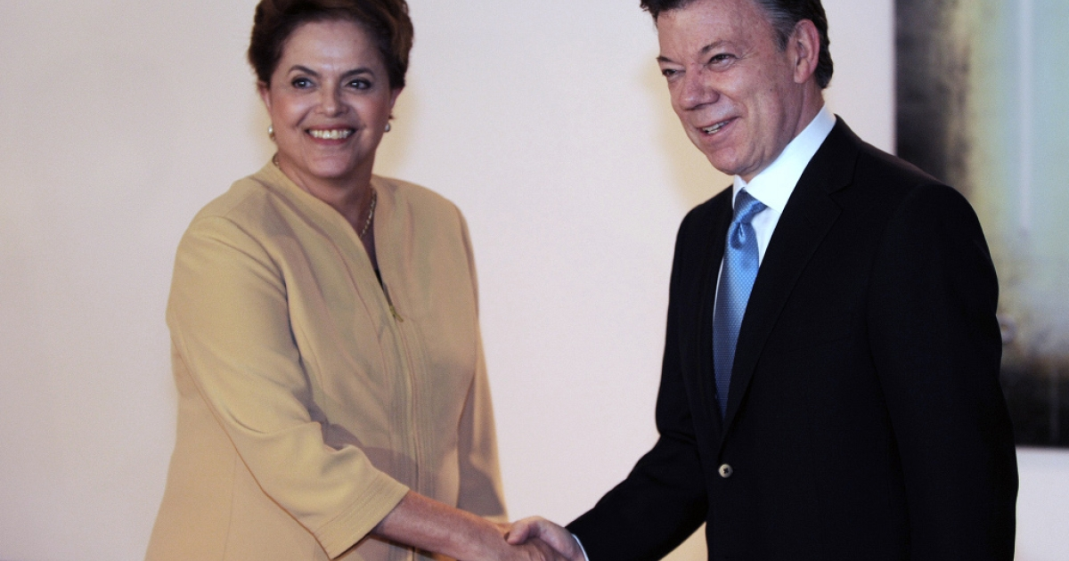 Colombian President Juan Manuel Santos and Dilma Rousseff, presidential candidate for the ruling Workers Party (PT), shake hands during a meeting in Brasilia, on September 1, 2010.</p>