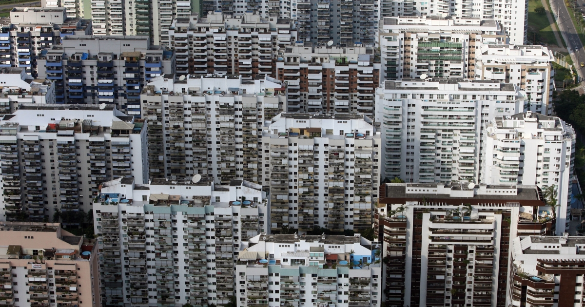 High-rise condos sprout up after a construction boom in Brazil's upper-middle-class neighborhood of Barra de Tijuca in Rio de Janeiro.</p>