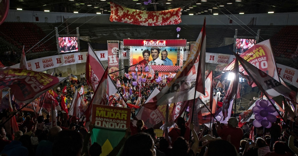 Supporters of Fernando Haddad, the mayoral candidate of the Workers Party (PT), wave banners during a campaign rally in Sao Paulo, Brazil, on October 20, 2012.</p>