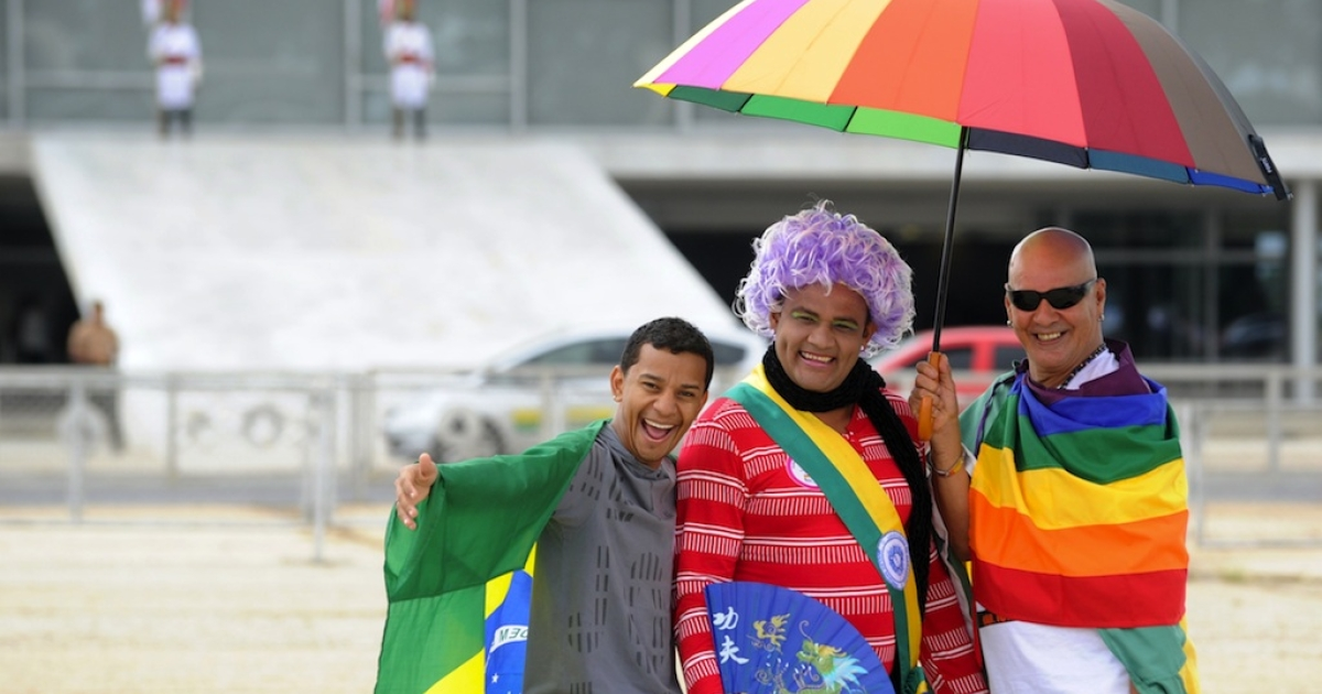 Gay activists pose in front of the Planalto Palace during the third National Demonstration Against Homophobia in Brasilia on May 16, 2012 as part of the International Day Against Homophobia.</p>