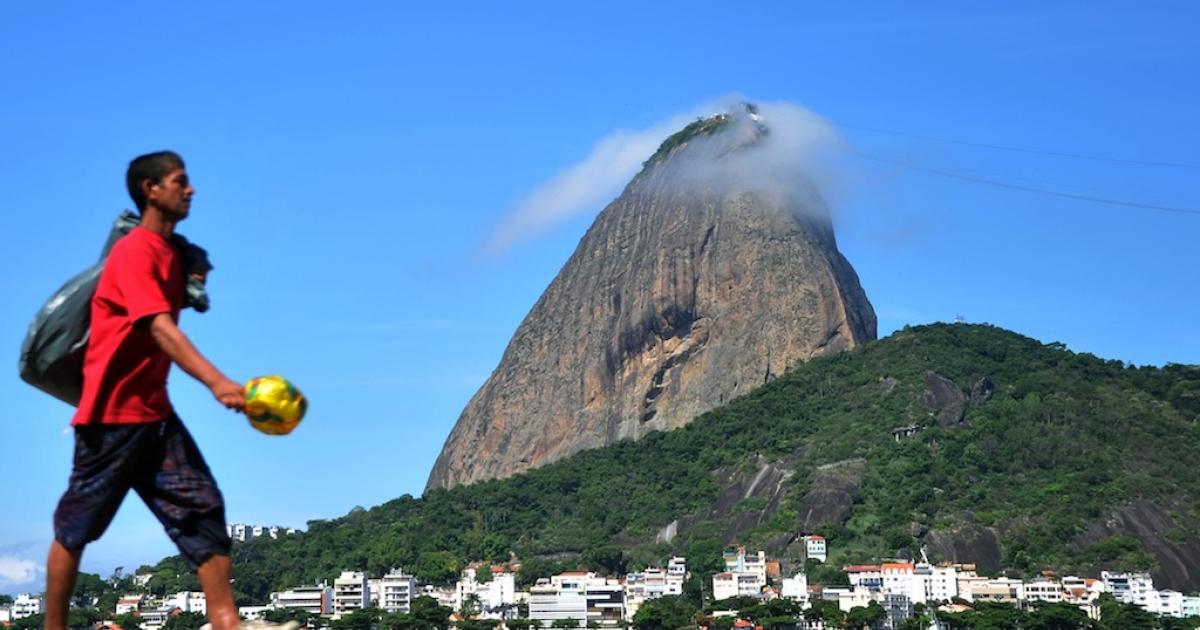 A man walks along Brazil's Botafogo beach on April 10, 2012.</p>