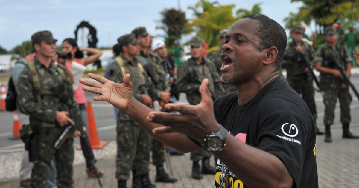 A demonstrator shouts to militarymen blocking the access to the Legislative Assembly building, which is being occupied by policemen on strike in Salvador, Bahia, Brazil. Police strikers occupying the state legislature in the Brazilian city of Salvador vowed Monday to resist if troops try to evict them amid escalating violence.</p>
