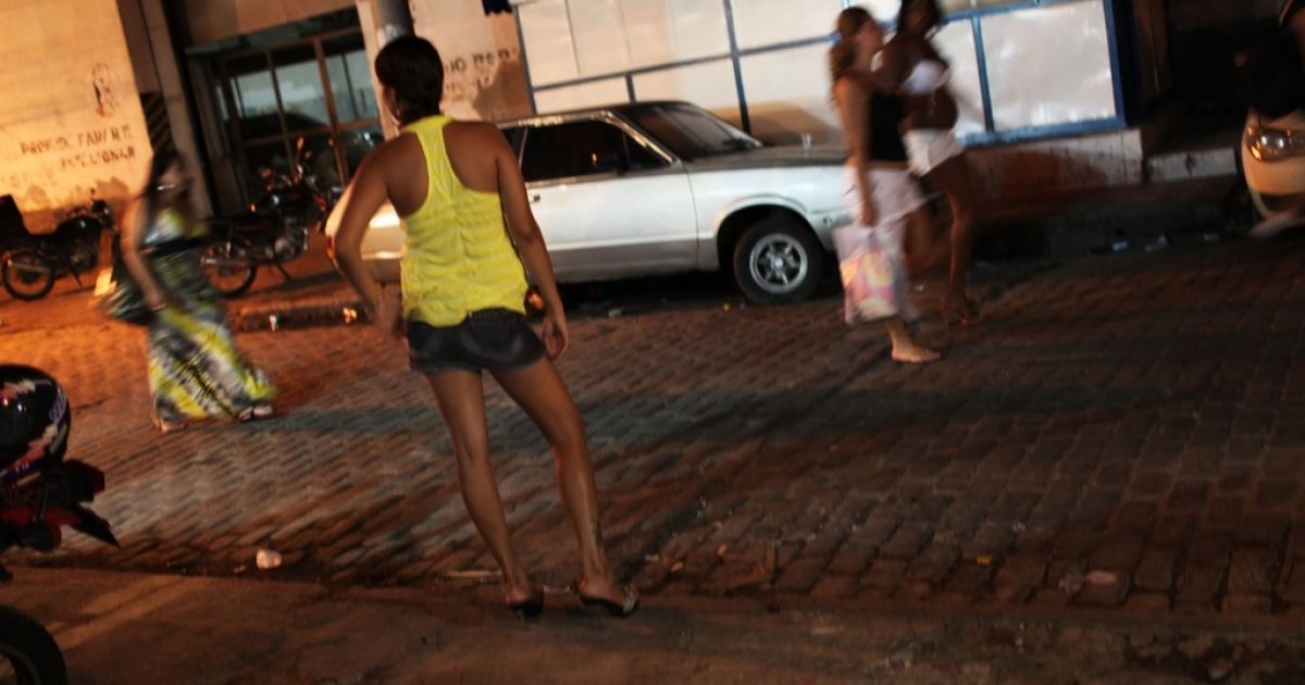 Female prostitutes walk the streets of the red light district, Vila Mimosa, following a fashion show of clothes designed by sex workers on December 11, 2009 in Rio de Janeiro, Brazil.</p>