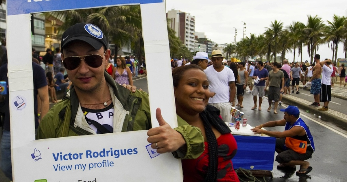 A reveller dressed as a Facebook profile joins a parade in Rio de Janeiro on March 5, 2011.</p>
