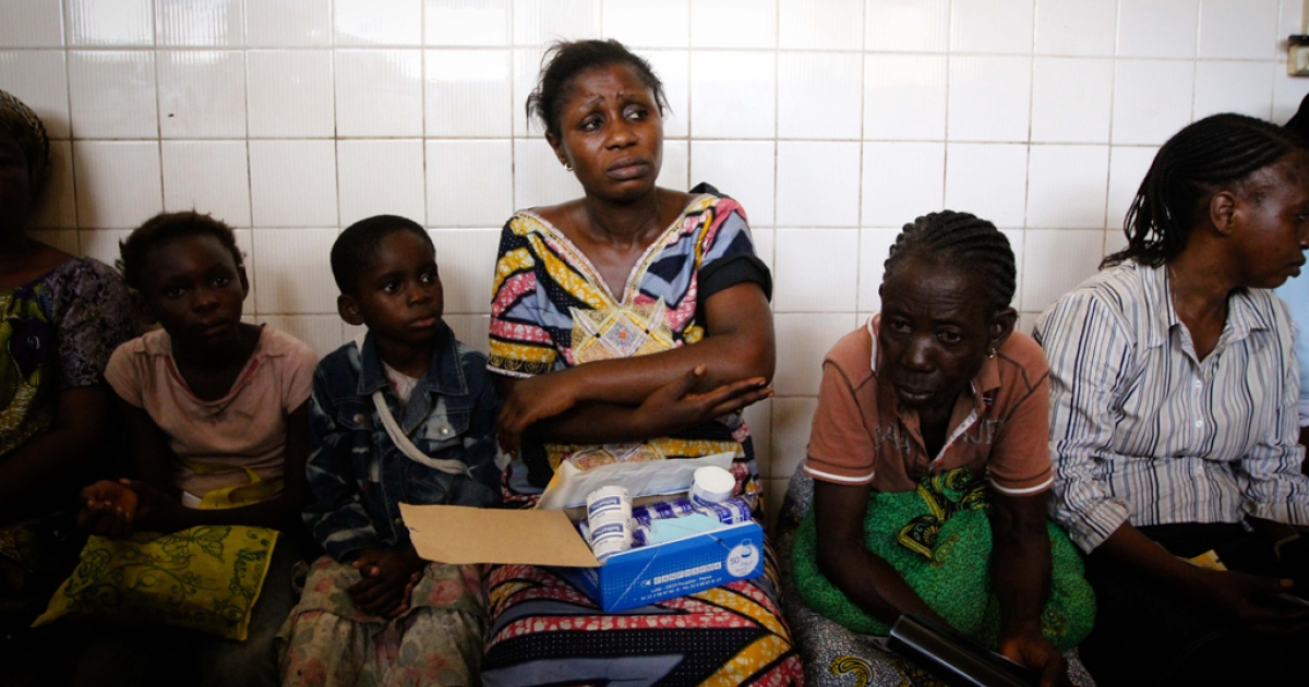 A woman sits in the overcrowded waiting room of the central hospital, holding her broken arm and waiting for treatment, after huge explosions on March 4 at a munitions depot in Brazzaville left more than 200 dead and 1,500 injured. The government said an electrical short-circuit likely caused a fire which triggered a series of blasts so powerful they devastated the surrounding area and blew out windows in Kinshasa, the capital of the neighboring Democratic Republic of Congo situated across the Congo river.</p>