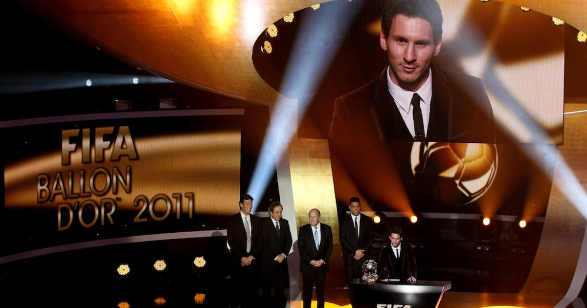 Lionel Messi of Barcelona receives the FIFA Ballon d'Or 2011 trophy on January 9, 2012 in Zurich, Switzerland.</p>