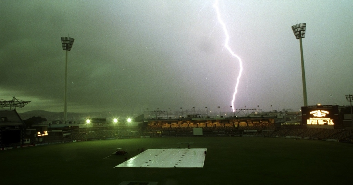 A file photo shows a lightning strike as a massive thunder storm stops play in the first test between England and Australia at the Gabba in Brisbane, Australia.</p>