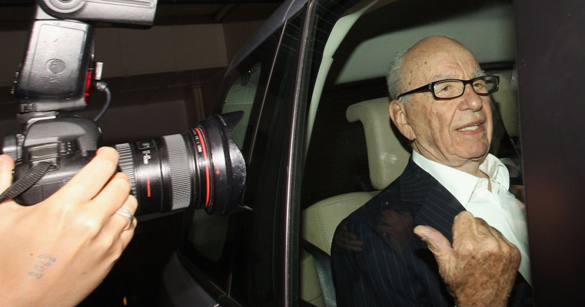 Rupert Murdoch, the chief executive officer of News Corp., is driven from his apartment on July 12, 2011 in London.</p>