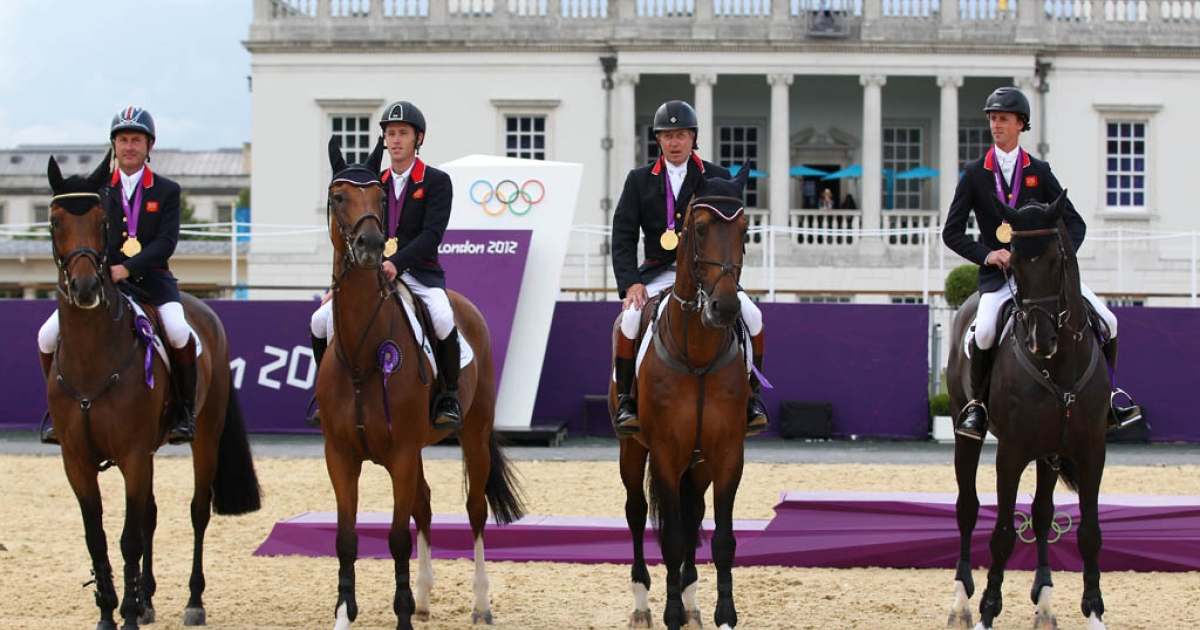 LONDON, ENGLAND - AUGUST 06:  (L-R) Gold medalists Nick Skelton riding Big Star, Ben Maher riding Tripple X, Scott Brash riding Hello Sanctos and Peter Charles of Great Britain riding Vindicat celebrate on the podium during the medal ceremony for the Team Jumping on Day 10 of the London 2012 Olympic Games at Greenwich Park on August 6, 2012 in London, England.  (Photo by Alex Livesey/Getty Images)</p>