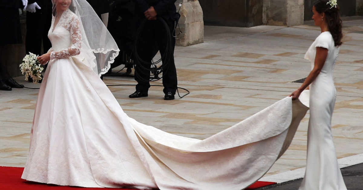 Kate Middleton looks back at her maid of honor, sister Pippa, after arriving at Westminster Abbey in London, England for her wedding to Prince William on April 29, 2011. Her dress is by Sarah Burton for Alexander McQueen.</p>
