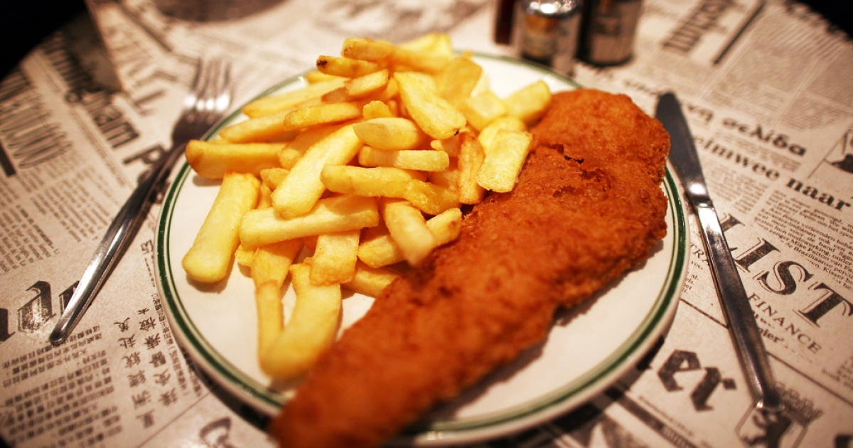 A traditional dish of Fish and Chips is placed on a table in a cafe on February 22, 2011 in London, England.</p>