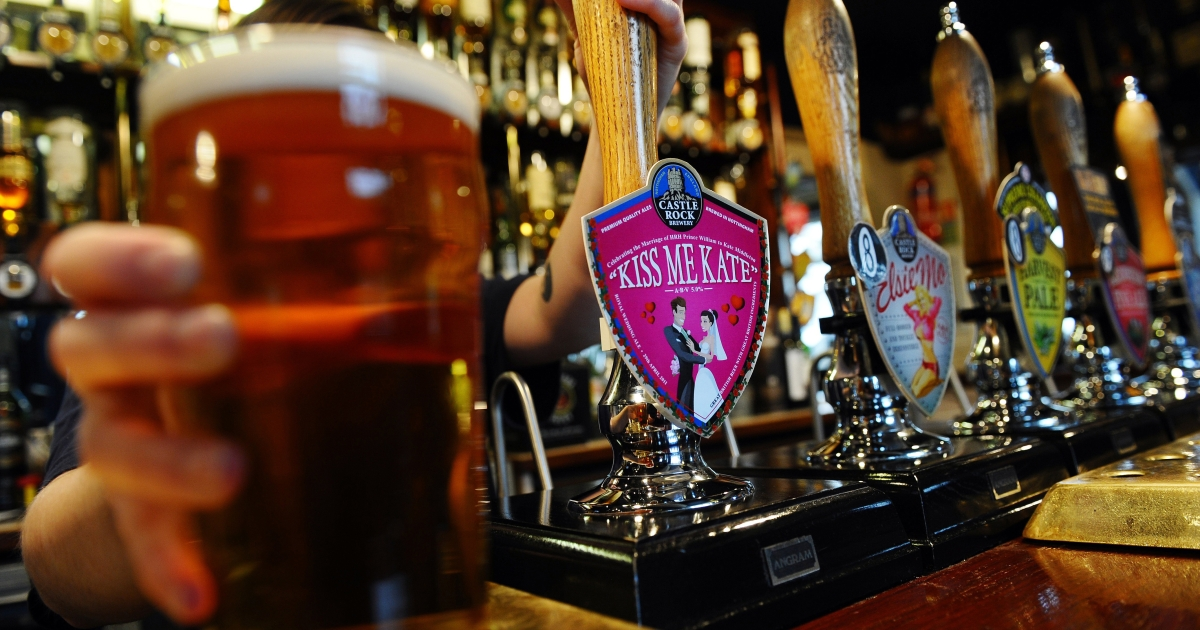 A pint of 'Kiss me Kate' beer is pulled at the bar of the Castle Rock Brewery in Nottingham, central England, on Mar. 30, 2011.</p>