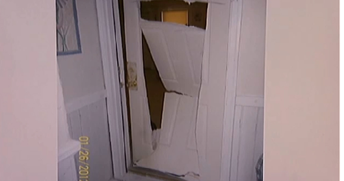 This screen grab from local news station WHDH shows the door the FBI mistakenly chainsawed though.</p>