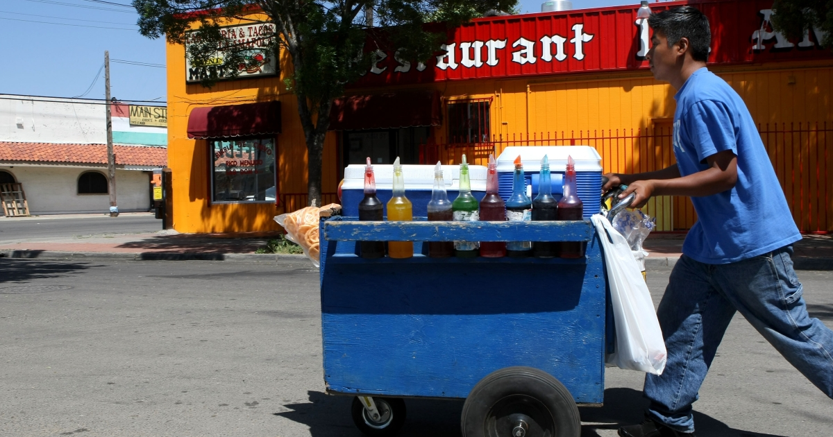 A snow cone vendor pushes his cart down a street in April 2008 in Stockton, California. Stockton's economy has been suffering for years. In 2008, one in every 30 Stockton homes was in foreclosure. In 2012, Stockton is preparing to become the largest US city in history to file for bankruptcy.</p>