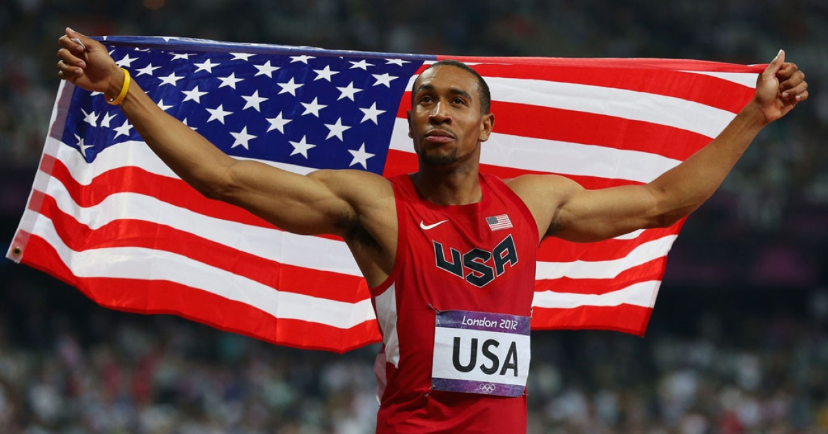 Bryshon Nellum of the United States celebrates after winning silver in the men's 4x400 relay on Day 14 of the London 2012 Olympic Games on August 10, 2012 in England.</p>